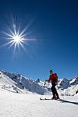Man on touring skis, Grisons, Switzerland, Europe