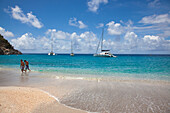 People at Governor's Beach with sailboats at anchor, Gustavia, Saint Barthelemy (St. Barth)
