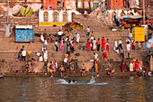 People wash themselves and pray in water of Ganges river at Dasaswamedh Ghat, Varanasi, Uttar Pradesh, India