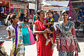 Women and child in colorful clothing, Porbandar, Gujarat, India