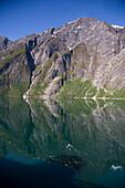 Shadow of cruise ship MS Deutschland (Reederei Peter Deilmann) in fjord water, Geiranger, More og Romsdal, Norway