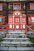 Ornamental door on wooden building at Sverresborg Trøndelag Folk Museum, Trondheim, Sør-Trøndelag, Norway