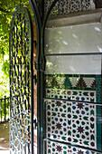 Mudejar tiles with Moorish geometric patterns  on doorway of Alcazar, Seville, Andalusia, Spain