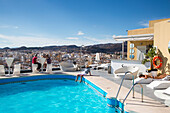 People relax at rooftop swimming pool of AC Hotel Malaga Palacio by Marriott, Malaga, Costa del Sol, Andalusia, Spain