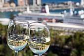Reflection of cruise ship MS Deutschland (Reederei Peter Deilmann) in wine glasses, Malaga, Costa del Sol, Andalusia, Spain