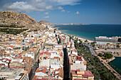 Overhead of city and Castillo de Santa Barbara castle on hillside, Alicante, Andalusia, Spain