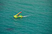 Floating water slide at Cala Galdana bay, Cala Galdana, Menorca, Balearic Islands, Spain