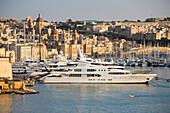 Luxury yachts and sailboats at Kalkara marina seen from Upper Barrakka Gardens, Valletta, Malta