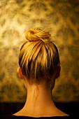 Woman wearing hair in chignon, rear view