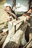 Woodworker splitting wood