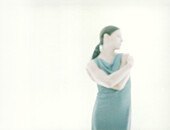 Woman standing with arms across chest, defocused and overexposed
