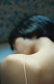 Close-up of woman's bare shoulder