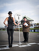 Gridgirl and course clerk, Goodwood Revival 2014, Racing Sport, Classic Car, Goodwood, Chichester, Sussex, England, Great Britain