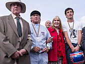 Sir Jackie Stewart (ML), Lady Helen Stewart (MR), Mark Webber (R), Goodwood Revival 2014, Racing Sport, Classic Car, Goodwood, Chichester, Sussex, England, Great Britain
