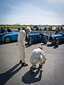 Driver in front of Bugatti racing cars, Williams Trophy, 72nd Members Meeting, racing, car racing, classic car, Chichester, Sussex, United Kingdom, Great Britain