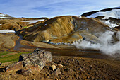 Geothermal area Hveradalir, steam is rising out of colorful rhyolith mountains, volcanoe mountains Kerlingarfjoll, Highlands, South Iceland, Iceland, Europe