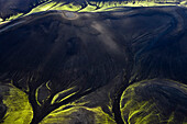 Aerial view of volcanic dark mountains covered with fluorescent mosses, Veidivotn, Highlands, South Iceland, Iceland, Europe