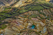 Aerial view of a small lake, rivers and colorful rhyolith mountains, geothermal area of Landmannalaugar, Laugarvegur, Highlands, South Iceland, Iceland, Europe