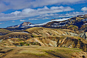 Aerial view of colorful, snow covered rhyolith mountains, geothermal area of Landmannalaugar, Laugarvegur, Highlands, South Iceland, Iceland, Europe