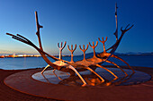 Solfar Sculpture, Viking ship, landmark at the seaside with view towards harbour and mountains of Esja, capital Reykjavik, Iceland, Europe