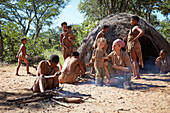 Tourists in the village of the San people, Khaudum, Namibia