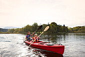 Mother and son canoe touring on lake Staffelsee, Seehausen, Upper Bavaria, Germany