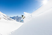 freeride skier jumps over snow cornice, Zugspitze, overlooking and Hochwanner, Upper Bavaria, Germany