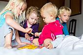 4 children playing together, friendship, MR, Soller, Serra de Tramuntana, Majorca, Balearic Islands, Spain, Europe