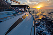 A sailing yacht in the sunset at the northern shore of Mallorca, Balearic Islands, Spain, Europe
