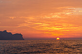 A sailing yacht in sunset on the northern shore of Mallorca, Balearic Islands, Spain, Europe