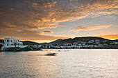 Boat crossing the harbor of Siros at sunrise, Greek Islands, Aegean, Cyclades, Greece
