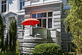 Modern red parasol on the balcony of an art nouveau house in Hamburg, Hamburg, Germany