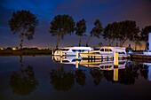 Le Boat Royal Mystique and Vision 3 houseboats at Westhoek Marina at night, Nieuwpoort, Flemish Region, Belgium