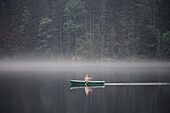 Rowing boat on Lake Hintersee near Ramsau, Berchtesgaden, Upper Bavaria, Bavaria, Germany
