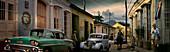 Street scene with oldtimer, horse and Che Guevara wall painting, Trinidad, Sancti Spiritus, Cuba, Carribean, North America, America