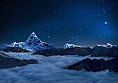 Night sky over snowcapped mountains, Pokhara, Kaski, Macchapucchare, Annapurna, Nepal, Asia