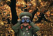 Soldier looking through binoculars, Military, Autumnal tree in the background, Kumgangsan, North Korea, Asia