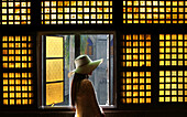 Woman standing by the capiz window inside the San Agustin church, Intramuros, Manila, Philippines, Asia