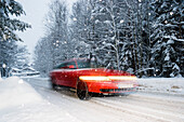 car at snow flurry, road traffic in winter, Bavaria, Germany