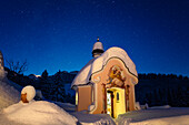 Chapel in winter with starry sky, Upper Bavaria, Germany, Europe