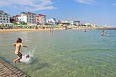 Holiday makers on the beach, Jesolo, Veneto, Adriatic, Italy