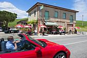 Porsche Cabrio outside a cafe, bar, restaurant on a road, San Quirico D´orcia, Tuscany, Italy, Europe