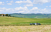 Jaguar C-Type near a winery near Pienza, Tuscany, Italy, Europe