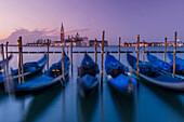 Blurred view of gondolas on urban canal, Venice, Veneto, Italy, Venice, Veneto, Italy