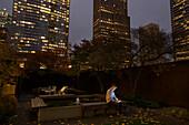 Caucasian businessman using digital tablet in urban courtyard, Seattle, Washington, USA