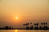 Sun setting over tropical ocean, Alleppey, Kerala, India