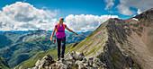 Caucasian girl hiking on rocky mountain, Fort William, Scotland, UK