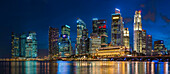 Skyscrapers in Singapore city skyline illuminated at night, Singapore, Singapore, Singapore, Singapore
