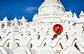Asian woman sitting on temple walls, Mingun, Saigang, Myanmar, Mingun, Saigang, Myanmar