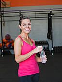 Caucasian woman smiling in gym, Laguna Niguel, California, USA